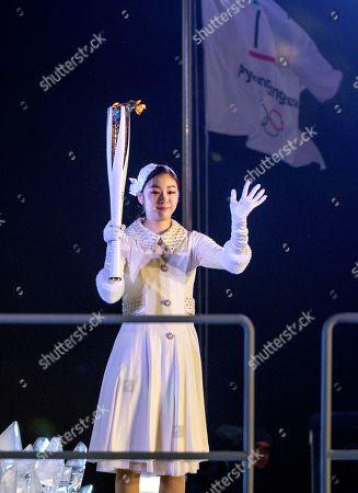South Korean Olympic figure skating champion Kim Yuna lights the Olympic flame