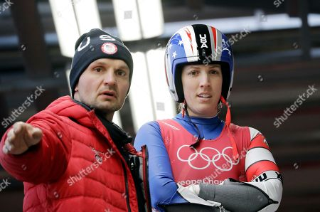 Erin Hamlin of the United States and her coach Lubomir Mick discuss the course before a training run at the 2018 Winter Olympics in Pyeongchang, South Korea