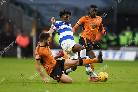 Eberechi Eze of Queens Park Rangers is challenged by Alfred N'Diaye of Wolverhampton Wanderers and Ruben Neves of Wolverhampton Wanderers.