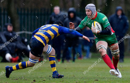 Dan Williams of Plymouth Albion hands off Hamish Barton, Captain of Old Elthamians during the National Division 1 match between Plymouth Albion v Old Elthamians at the College Meadow, on February 10th 2018, Eltham, London, UK.
