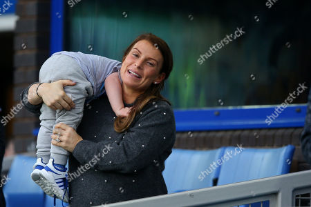 Coleen Rooney with son Kit in the stands prior to kick-off