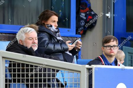 Coleen Rooney looks on from the stands during the game