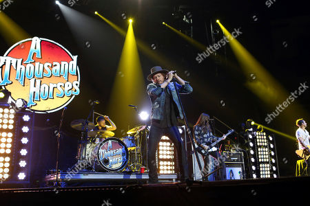 Zach Brown, Michael Hobby, Graham DeLoach, Bill Satcher. Zach Brown, Michael Hobby, Graham DeLoach and Bill Satcher with A Thousand Horses performs as the opener for Kid Rock at the Infinite Energy Arena, in Atlanta