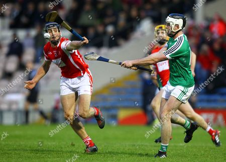 Stock Photo of Cuala vs Liam Mellows. Adrian Morrissey of Liam Mellows in action against Cuala's Mark Schütte
