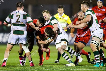 Jason Harris-Wright and Siale Piutau of Bristol Rugby is challenged by Mark Bright (capt) of Ealing Trailfinders