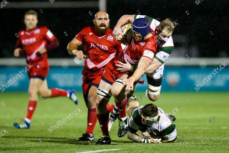 Sam Jeffries of Bristol Rugby is tackled by Mark Bright (capt) of Ealing Trailfinders