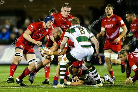 James Lay of Bristol Rugby is challenged by Mark Bright (capt) of Ealing Trailfinders