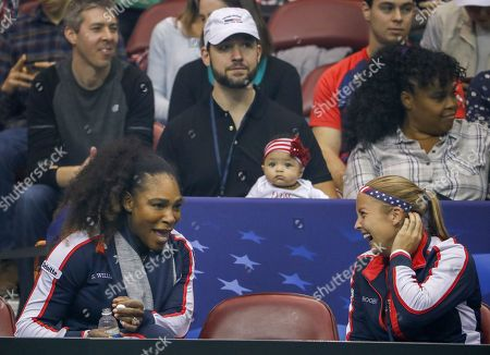 Serena Williams (L) of the US speaks with Shelby Rogers (R) as Williams' husband Alexis Ohanian (C) holds their daughter Alexis Olympia Ohanian Jr during a Fed Cup World Group first round women's tennis match between the United States and the Netherlands at the US Cellular Center in Asheville, North Carolina, USA, 10 February 2018.