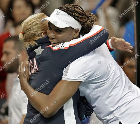 Stock Image of Lisa Raymond, Venus Williams. USA's Venus Williams, right, hugs team coach Lisa Raymond, left, after defeating Netherlands' Arantxa Rus during a match in the first round of Fed Cup tennis competition in Asheville, N.C