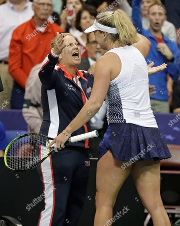 Coco Vandeweghe, Lisa Raymond. USA team coach Lisa Raymond, left, hugs Coco Vandeweghe after Vandeweghe defeated Netherlands' Richel Hogenkamp during a match in the first round of Fed Cup tennis competition in Asheville, N.C