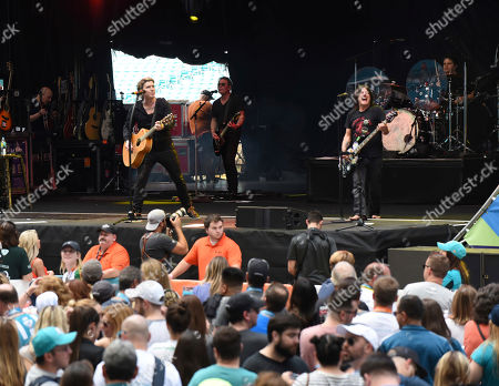 John Rzeznick, Robby Takac. John Rzeznick, left, and Robby Takac of The Goo Goo Dolls perform at the Dolphins Cancer Challenge V111 on in Miami Gardens, Fla