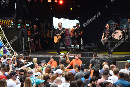 Stock Image of John Rzeznick, Robby Takac. John Rzeznick, left, and Robby Takac of The Goo Goo Dolls perform at the Dolphins Cancer Challenge V111 on in Miami Gardens, Fla