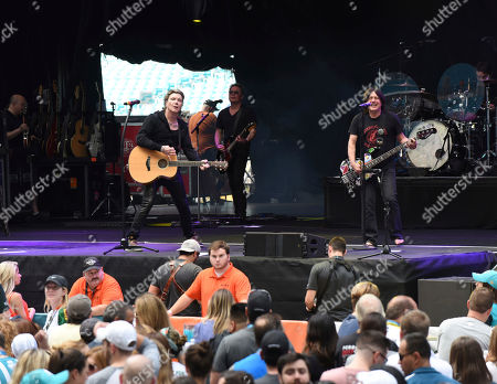 Stock Picture of John Rzeznick, Robby Takac. John Rzeznick, left, and Robby Takac of The Goo Goo Dolls perform at the Dolphins Cancer Challenge V111 on in Miami Gardens, Fla