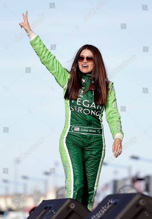 Stock Picture of Leilani Munter waves to fans before the start of the ARCA auto race at Daytona International Speedway, in Daytona Beach, Fla