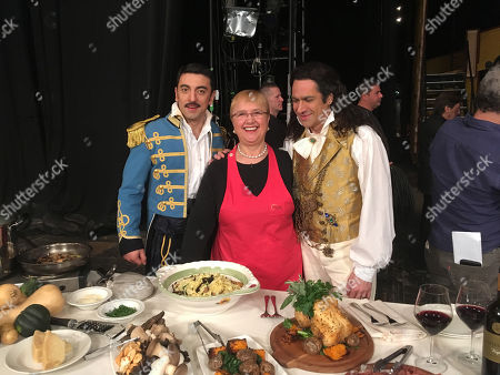 """Baritone Davide Luciano, in the role of Sgt. Belcore, left, and bass Ildebrando D'Arcangelo, right, flank chef Lidia Bastianich during intermission Saturday, Feb. 10. 2018, of a performance at Donizetti's """"L'Elisir d'Amore"""" (The Elixir of Love) at the Metropolitan Opera in New York. Instead of a prop, D'Arcangelo was served fresh pasta cooked by the celebrity chef"""