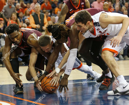 Justin Bibbs, Kyle Guy, Chris Clarke, Ty Jerome. Virginia Tech guard Justin Bibbs, left, fights for the ball with Virginia guard Kyle Guy, second from left, Virginia Tech forward Chris Clarke, second from right, and Virginia guard Ty Jerome, right, during the second half of an NCAA college basketball game in Charlottesville, Va., . Virginia Tech won the game 61-60