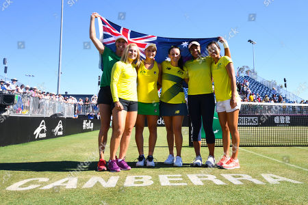 (L-R) Australian Fed Cup team captain Alicia Malik, Daria Gavrilova, Ashleigh Barty, Casey Dellacqua, Destinee Aiava, Lizette Cabrera pose for pictures after winning the Fed Cup World Group II Round 1 match between Australia and Ukraine at the Canberra Tennis Centre in Canberra, Australia, 11 February 2018.