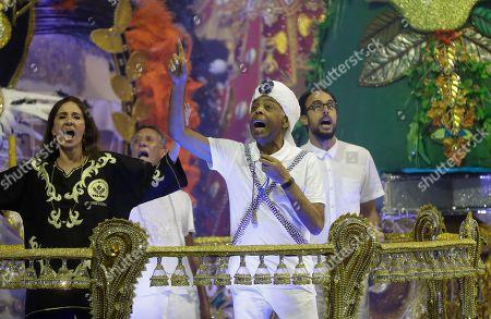 Brazilian singer Gilberto Gil performs at the Vai-Vai samba school during a carnival parade in Sao Paulo, Brazil