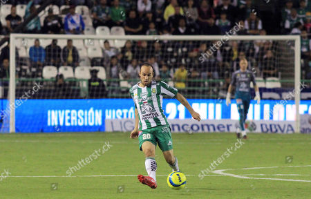 Leon's Landon Donovan plays the ball against Puebla during a Mexico soccer league match in Leon, Mexico
