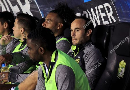 Leon's Landon Donovan, right, watches the game against Puebla from the dugout, during a Mexico soccer league match in Leon
