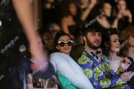 Cardi B., Brad Walsh, Jaimie Alexander. Cardi B., from left, Brad Walsh and Jaimie Alexander attend the Christian Siriano 2018 Fall/Winter Runway Show during New York Fashion Week at The Grand Lodge on in New York
