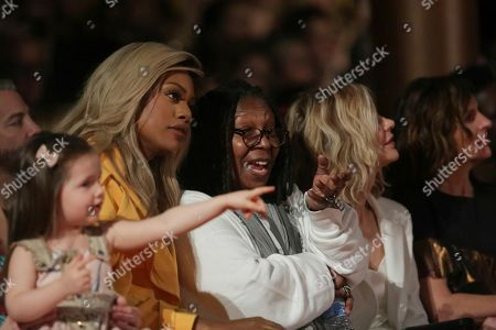 Ioni James Conran, Laverne Cox, Whoopi Goldberg, Meg Ryan, Molly Shannon. Ioni James Conran, from left, Laverne Cox, Whoopi Goldberg, Meg Ryan and Molly Shannon attend the Christian Siriano 2018 Fall/Winter Runway Show during New York Fashion Week at The Grand Lodge on in New York