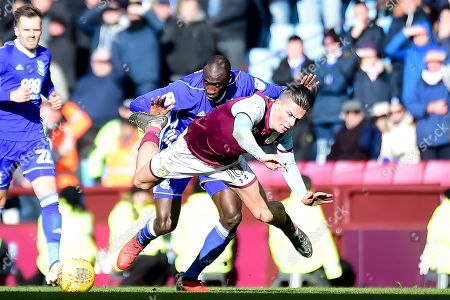 Stock Photo of Aston Villa midfielder Jack Grealish (10) is fouled by Birmingham City midfielder Cheikh N'Doye (17) during the EFL Sky Bet Championship match between Aston Villa and Birmingham City at Villa Park, Birmingham. Picture by Dennis Goodwin