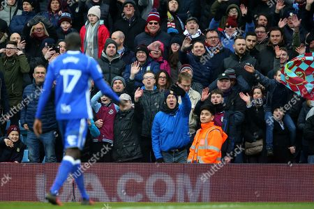 Aston Villa fans wave to Cheikh NDoye after he is sent off for a Red card offence