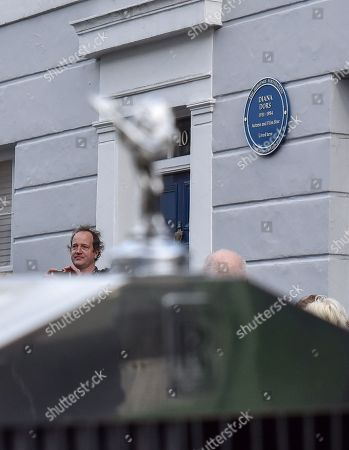 Jason Dors-Lake unveils the Blue Plaque to his mother, with her white Rolls Royce Silver Cloud Mk2 in the foreground