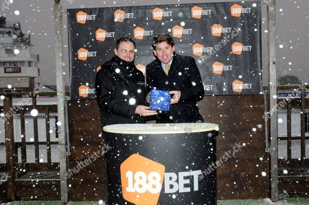Stock Photo of A very snowy presentation at Exeter to Jason Maguire [right] by Exeter General Manager Jack Parkinson [left].