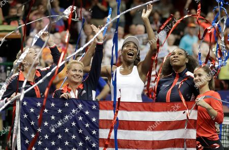 CoCo Vandeweghe, Lisa Raymond, Venus Williams, Serena Williams, Lauren Davis. Team USA, from left, CoCo Vandeweghe, coach Lisa Raymond, Venus Williams, Serena Williams and Lauren Davis celebrate after defeating Netherlands in the first round of Fed Cup tennis competition in Asheville, N.C
