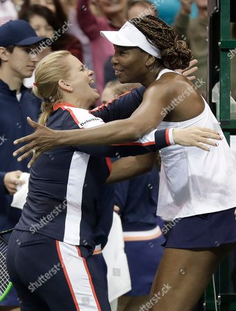 Stock Photo of Venus Williams, Lisa Raymond. USA's Venus Williams, right, is congratulated by coach Lisa Raymond, left, after defeating Netherlands during a match in the first round of Fed Cup tennis competition in Asheville, N.C