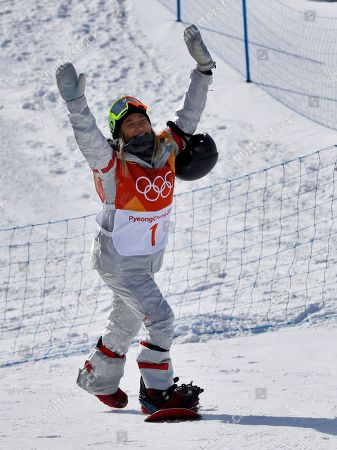 Chloe Kim, of the United States, reacts to fans during the women's halfpipe qualifying at Phoenix Snow Park at the 2018 Winter Olympics in Pyeongchang, South Korea