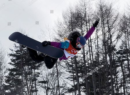 Verena Rohrer, of Switzerland, jumps during the women's halfpipe qualifying at Phoenix Snow Park at the 2018 Winter Olympics in Pyeongchang, South Korea
