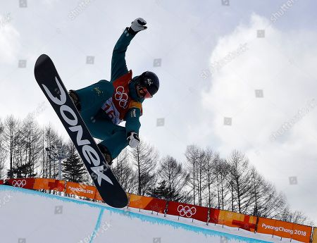 Holly Crawford, of Australia, jumps during the women's halfpipe qualifying at Phoenix Snow Park at the 2018 Winter Olympics in Pyeongchang, South Korea