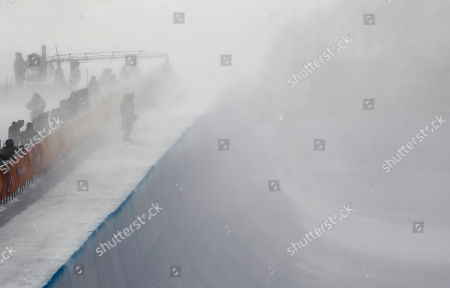 Wind gust engulfs the half pipe course during the women's halfpipe qualifying at Phoenix Snow Park at the 2018 Winter Olympics in Pyeongchang, South Korea