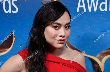 Actress Ivory Aquino poses at the 2018 Writers Guild Awards at the Beverly Hilton, in Beverly Hills, Calif