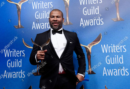 """Jordan Peele, writer/director of """"Get Out,"""" poses with his Outstanding Original Screenplay award backstage at the 2018 Writers Guild Awards at the Beverly Hilton, in Beverly Hills, Calif"""