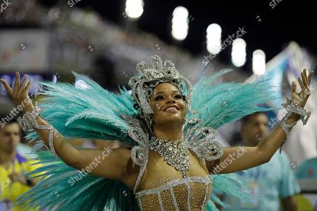 Drum queen Juliana Alves from the Unidos da Tijuca samba school performs during Carnival celebrations at the Sambadrome in Rio de Janeiro, Brazil