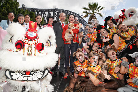 Sydney Lord Mayor Clover Moore (C-R) and Councillor Robert Kok (C-L) pose with performers at the launch of Chinese New Year, the Year of the Dog, at Dawes Point in Sydney, New South Wales, Australia, 12 February 2018.
