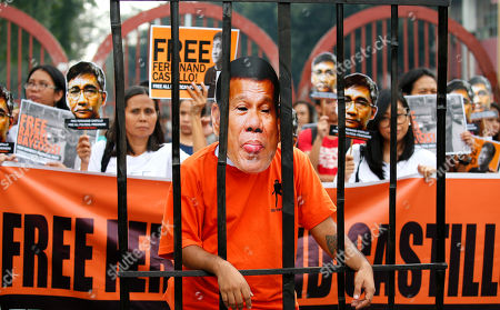Protesters display cutouts of detained communist peace talks consultant Ferdinand Castillo behind a mock jail cell of President Rodrigo Duterte during a rally to call for the release of Castillo's and another re-arrested communist leader Rafael Bayosis near the Presidential Palace in Manila, Philippines. Duterte ordered the arrest of communist rebel leaders following the collapse of the peace talks recently that was brokered by Norway. The protesters also condemned the Duterte's government alleged attacks on activists and critics