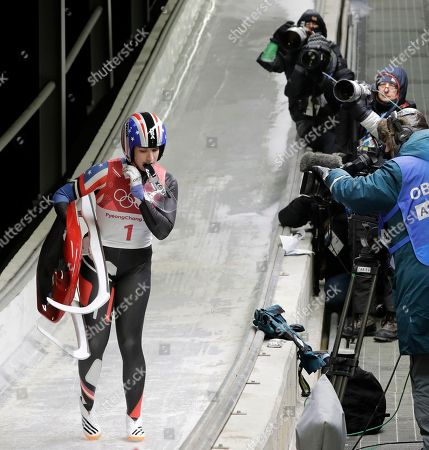 Erin Hamlin of the United States walks off the ice after her second run during the women's luge competition at the 2018 Winter Olympics in Pyeongchang, South Korea