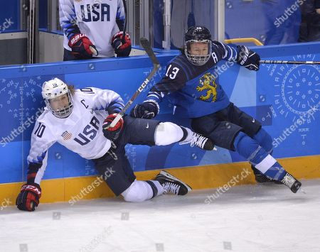 Riikka Välilä of Finland collides with Meghan Duggan (L) of USA during the women ice hockey preliminary round match Finland vs USA