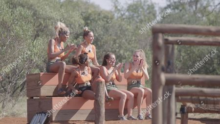 Mariam Musa, Jenny West, Tia Latham, Georgie Clarke and Georgia Cole watch Dani Mas Dyer and Callum Pardoe face off in the challenge