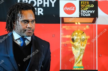 Christian Karembeu poses with the 2018 FIFA World Cup during the FIFA World Cup Trophy Tour presented by Coca-Cola at the Hilton Hotel