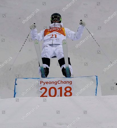 Stock Image of Felix Elofsson, of Sweden, jumps during the men's moguls qualifying at Phoenix Snow Park at the 2018 Winter Olympics in Pyeongchang, South Korea