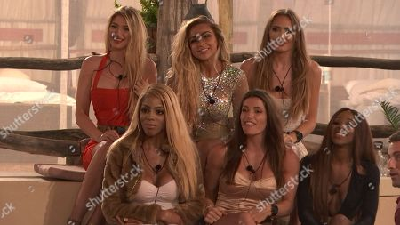 Lottie James, Georgia Cole, Georgie Clarke, Tia Latham, Jenny West and Mariam Musa as Laura enters The Lodge to tell the Teams that one of the Girls will be going home