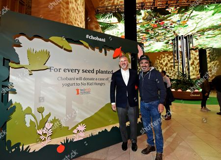 Peter Kaye, Hamdi Ulukaya. Hamdi Ulukaya, right, Chobani Founder and CEO, and Peter Kaye, of No Kid Hungry, announce a donation of a case of yogurt to the No Kid Hungry campaign for every seed planted at Chobani's activation at New York's Grand Central Terminal