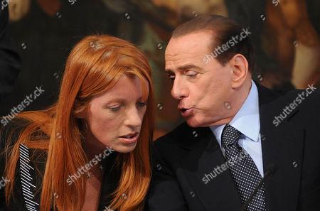 Tourism Minister Michela Vittoria Brambilla and Silvio Berlusconi
