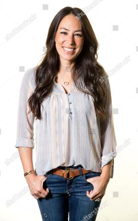 """Joanna Gaines poses for a portrait in New York to promote their home improvement show, """"Fixer Upper,"""" on HGTV."""
